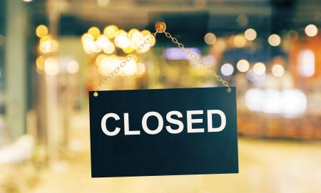 Close up of black closed sign hanging on glass door. Blurry background. Working hours concept. 3D Rendering