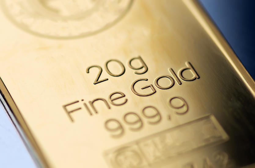 The Surface Of A Minted Gold Bar Weighing 20 Grams. Selective Fo