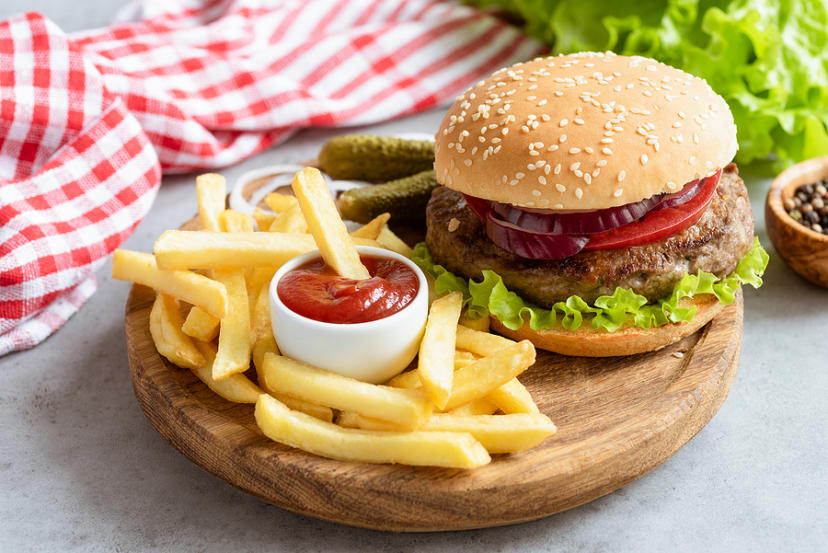 Homemade Beef Burger And French Fries With Ketchup On Wooden Boa