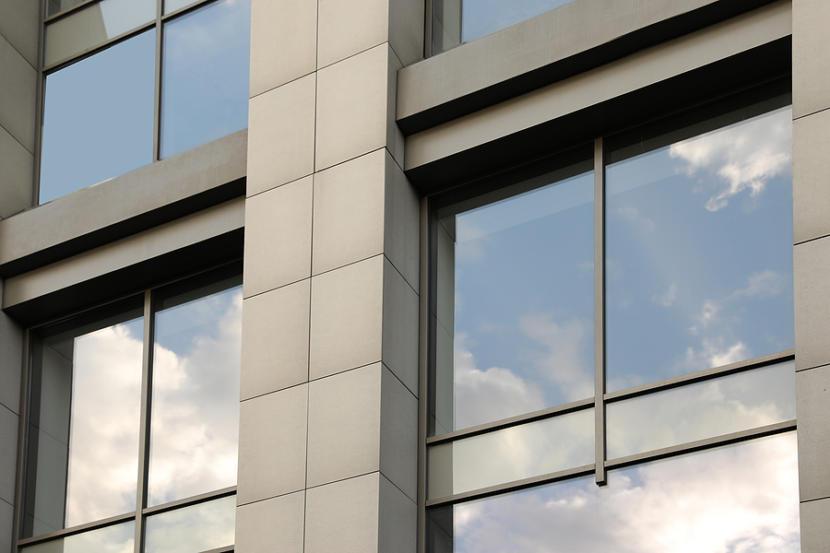 Modern Office Building With Tinted Windows. Urban Architecture
