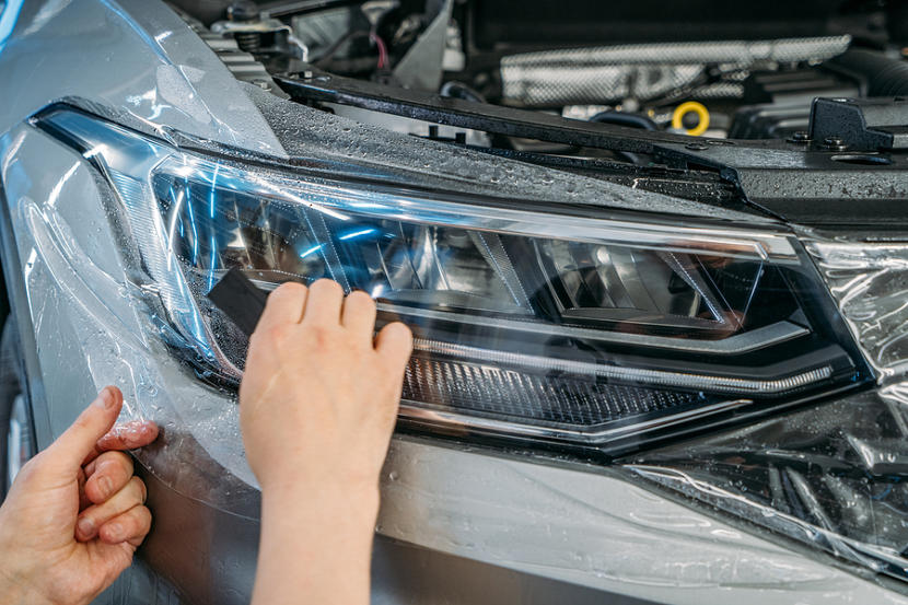 Workers Hands Wraps Wet Paint Protection Film Or Anti-gravel Pro